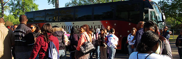 Group of students boarding tour bus